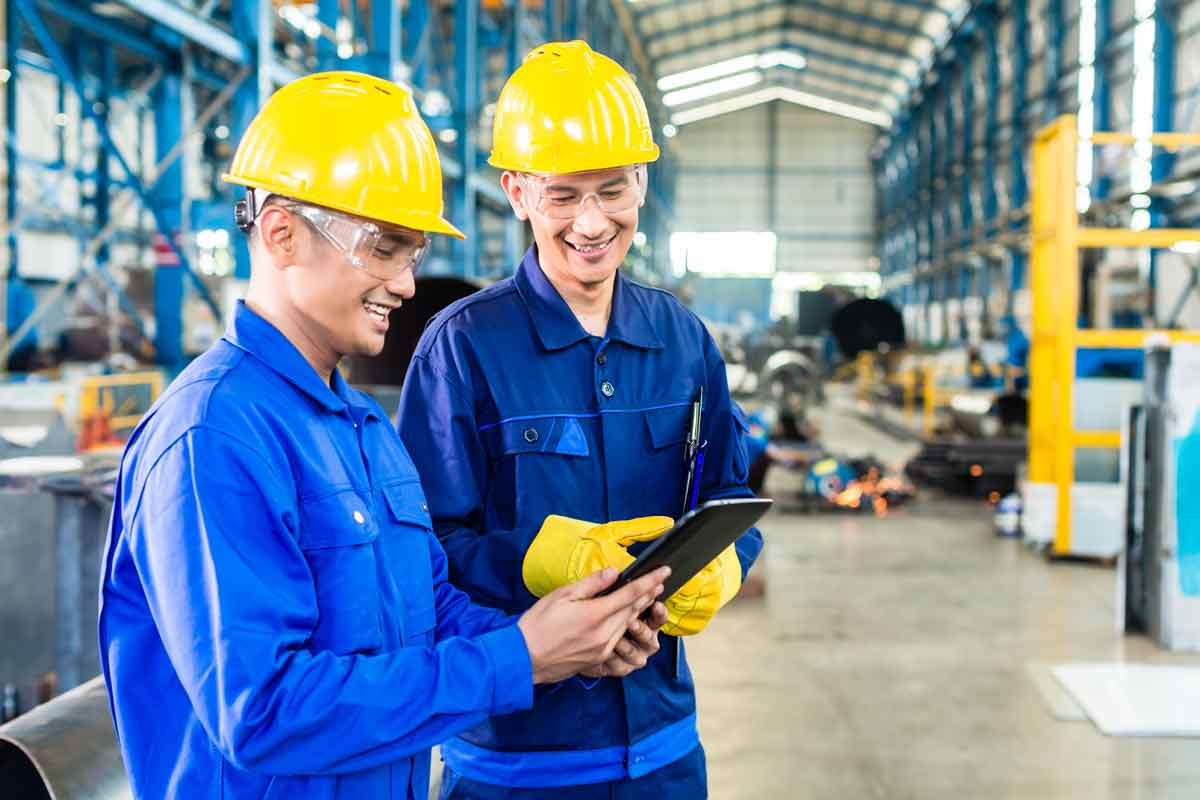 stockfresh_6856184_two-workers-in-production-plant-as-team_resized