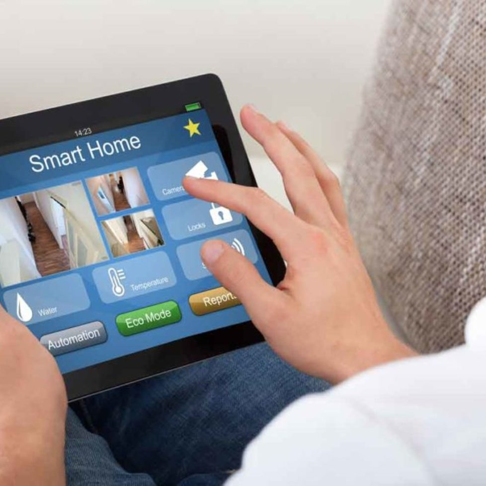stockfresh_7623029_person-using-home-control-system-on-a-digital-tablet_resized