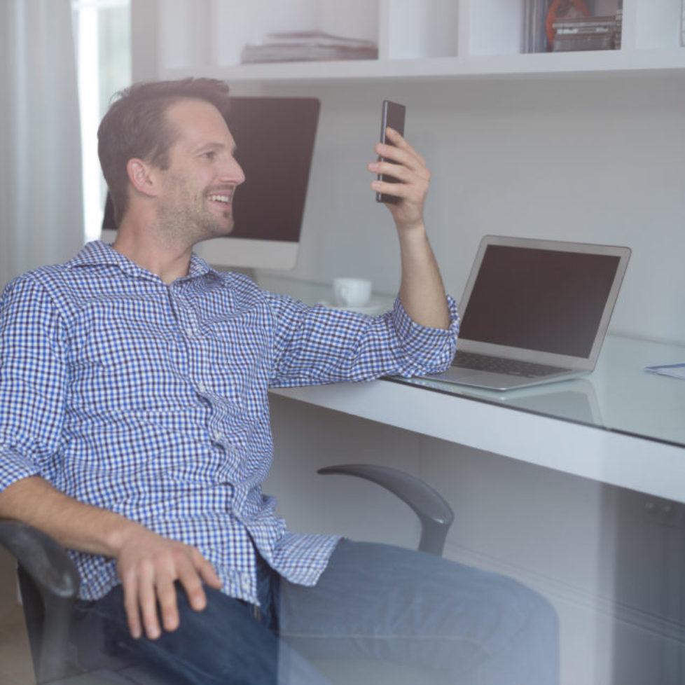 Man using mobile phone at desk